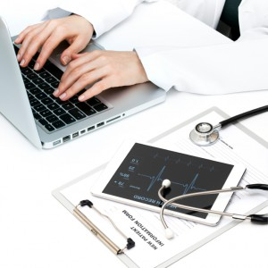Doctor working with healthcare software.